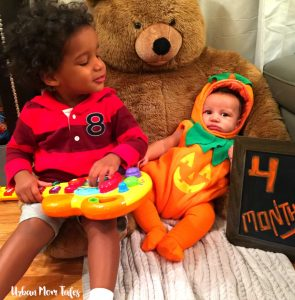 Miles Toddler Interrupting Baby Ellis 4 Month Baby Photo by singing to him