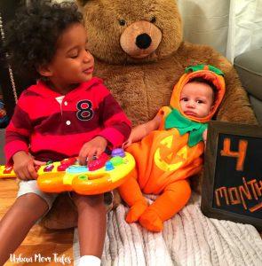 Miles Toddler Interrupting Baby Ellis 4 Month Baby Photo by singing to him