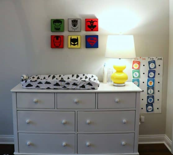 Boys superhero room with superhero logo canvas art squares.