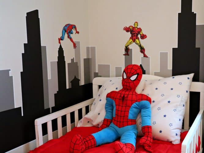 Superhero bed sheets with superhero wall decals and spiderman bed pillow.