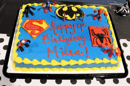 Cake with superhero figurines for birthday party